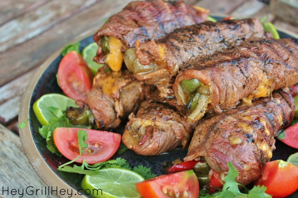 Steak Fajitas Roll Ups side view with peppers and cheese inside of the steak.