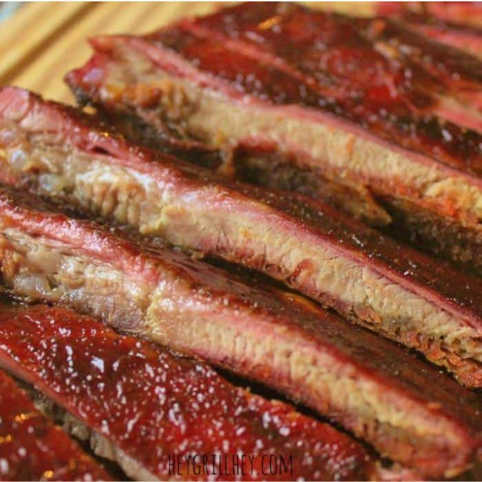 low and slow smoked ribs on a cutting board.