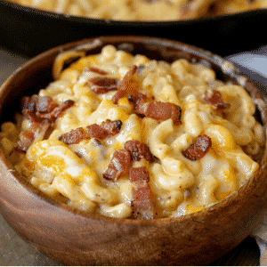 Bacon mac and cheese in a wooden bowl.