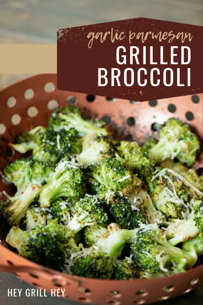 "Garlic Parmesan grilled broccoli in a copper vegetable basket. Text overlay: ""Garlic Parmesan Grilled Broccoli."""