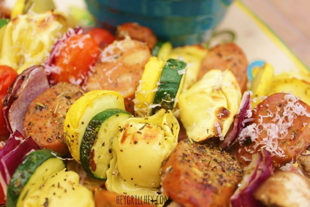 Grilled Italian Sausage and Tortellini Kebabs close up showing grilled sausage and seasoned vegetables.