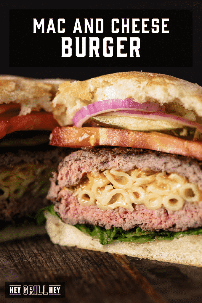 Mac and cheese stuffed hamburger sliced in half with text overlay - Mac and Cheese Burger.