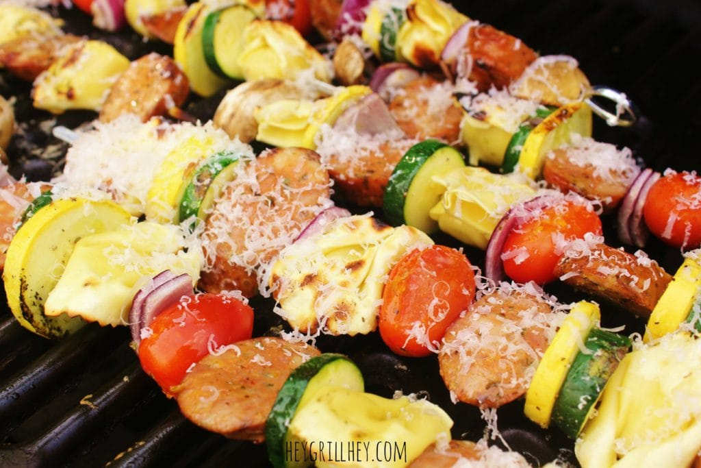 Italian Sausage and Tortellini skewers in a grill.