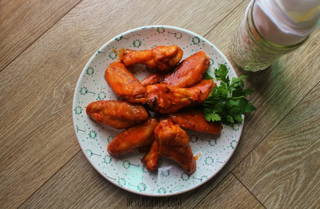 Ultimate Smoked Buffalo Chicken Wings on a white plate.