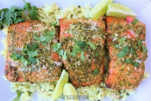 aerial view of grilled salmon prepared and served atop cooked rice