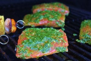 uncooked salmon topped with the cilantro lime marinade, placed directly on the grill grate inside the grill