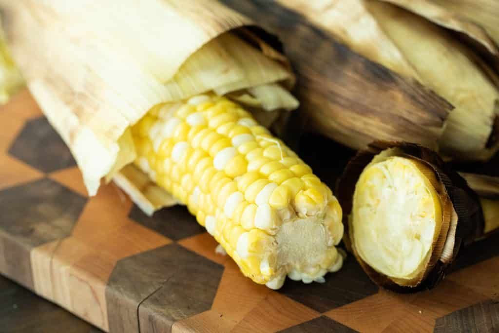 peeled easy grilled corn on the cob on a cutting board