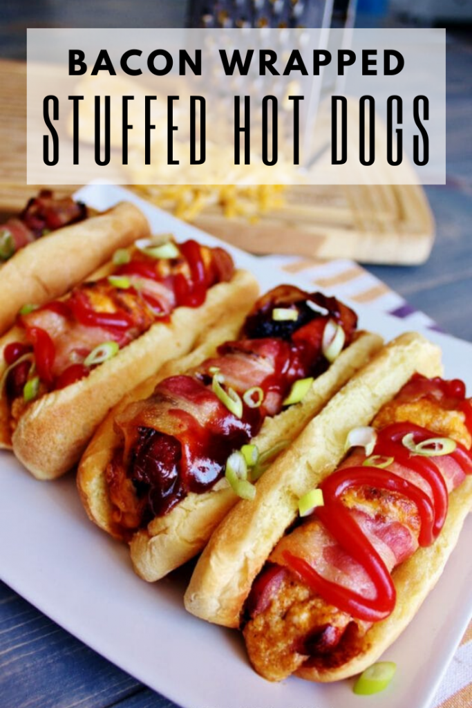 gourmet hot dogs on a white plate
