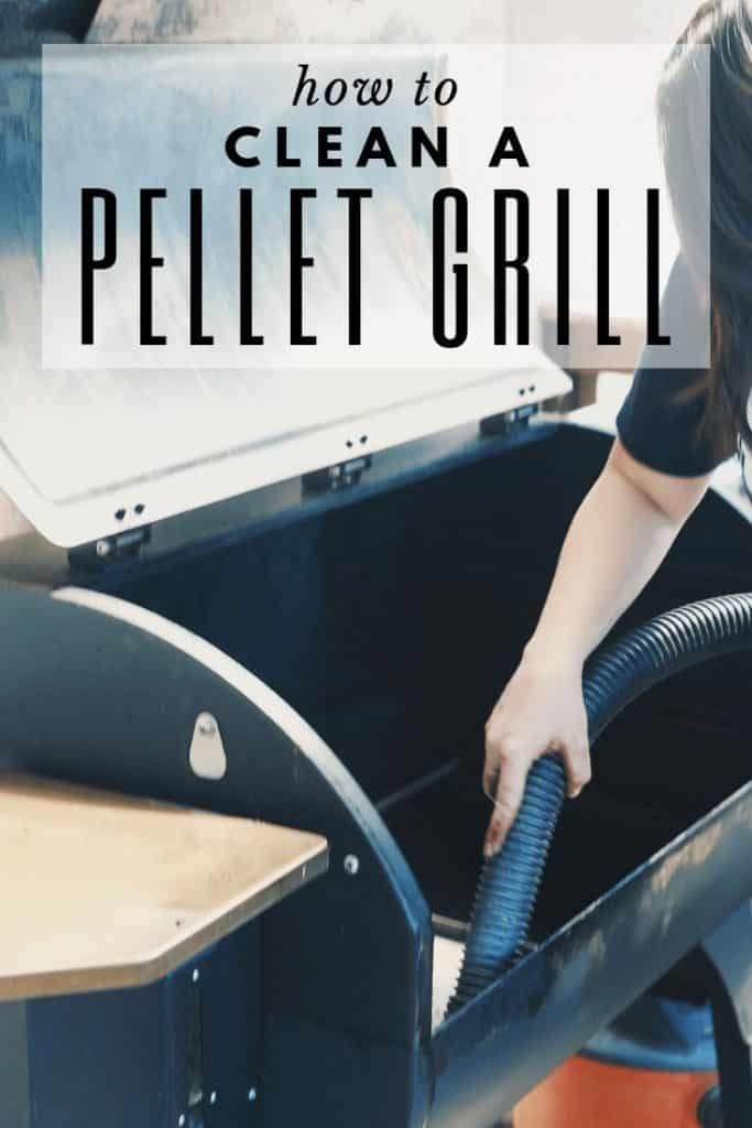 woman vacuuming out a pellet grill