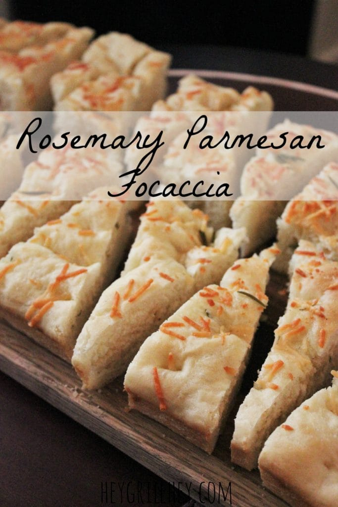 Rosemary Parmesan Focaccia Bread sliced in triangle shaped pieces, with text overlay that reads, Rosemary Parmesan Focaccia.