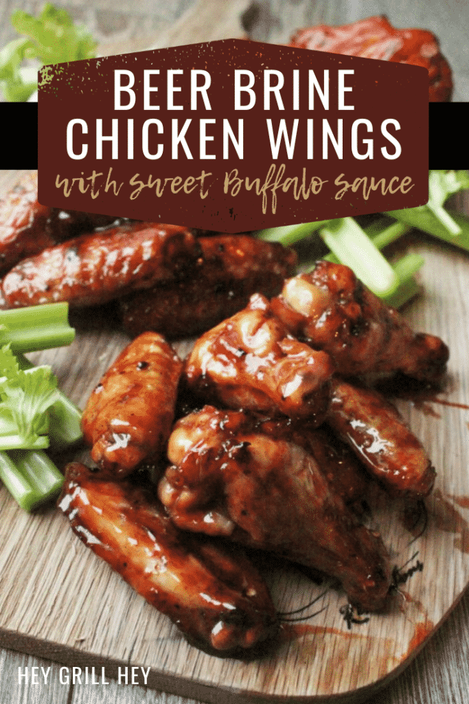 """beer brine chicken wings piled on a wooden cutting board next to sliced celery. Text overlay: """"Beer Brine Chicken Wings with Sweet Buffalo Sauce."""""""