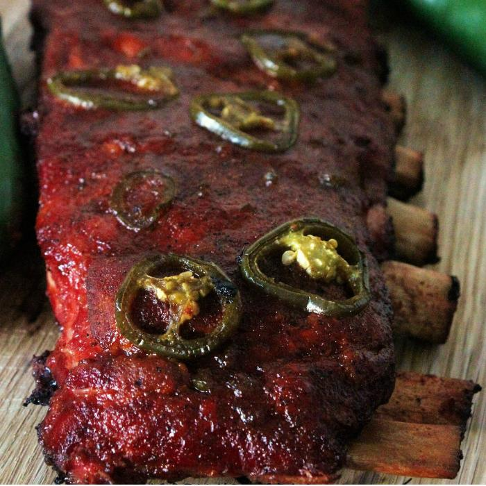 apple jalapeno smoked ribs on a wooden cutting board