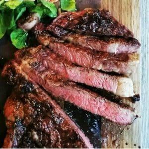 rib eye steaks on a cutting board