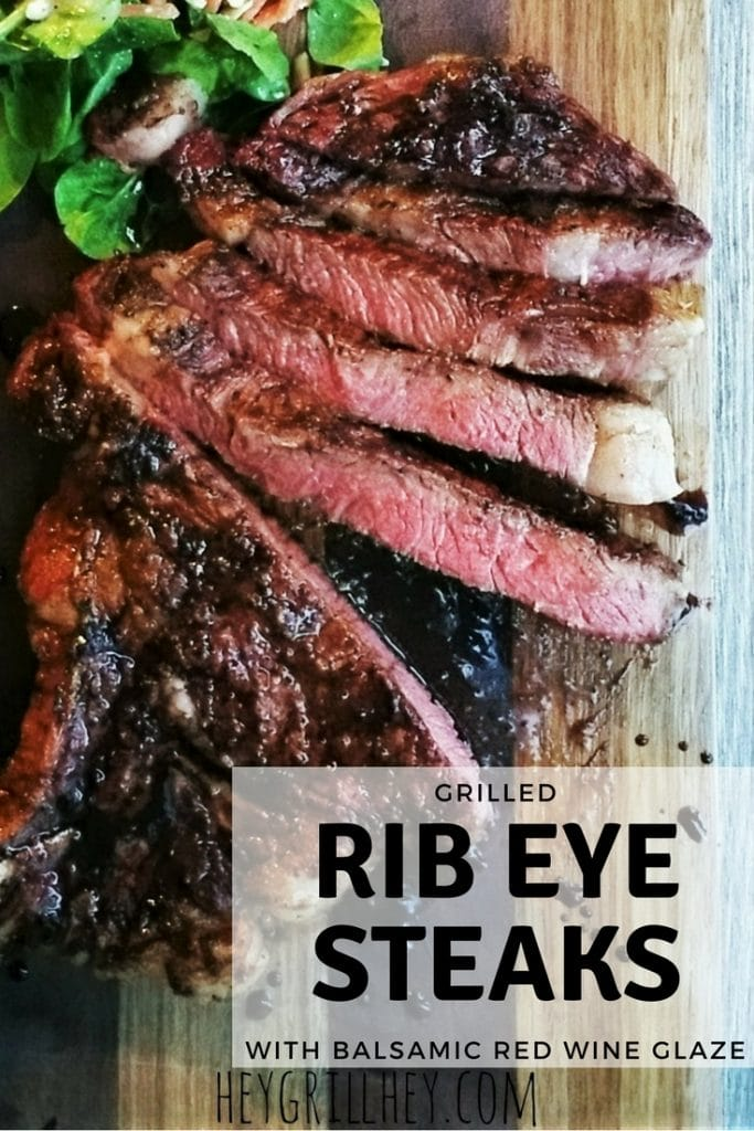 """Grilled Rib Eye steak, sliced and served on a wooden platter. Text overlay reads """"Grilled Rib Eye Steaks with Balsamic Red Wine Glaze."""""""