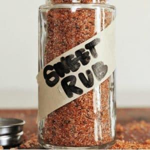 "The best sweet rub in a glass jar with the words ""sweet rub"" written in black marker across masking tape across the jar."