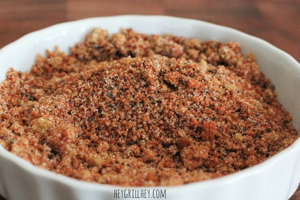 small white bowl full of mixed bbq rub for chicken and pork.