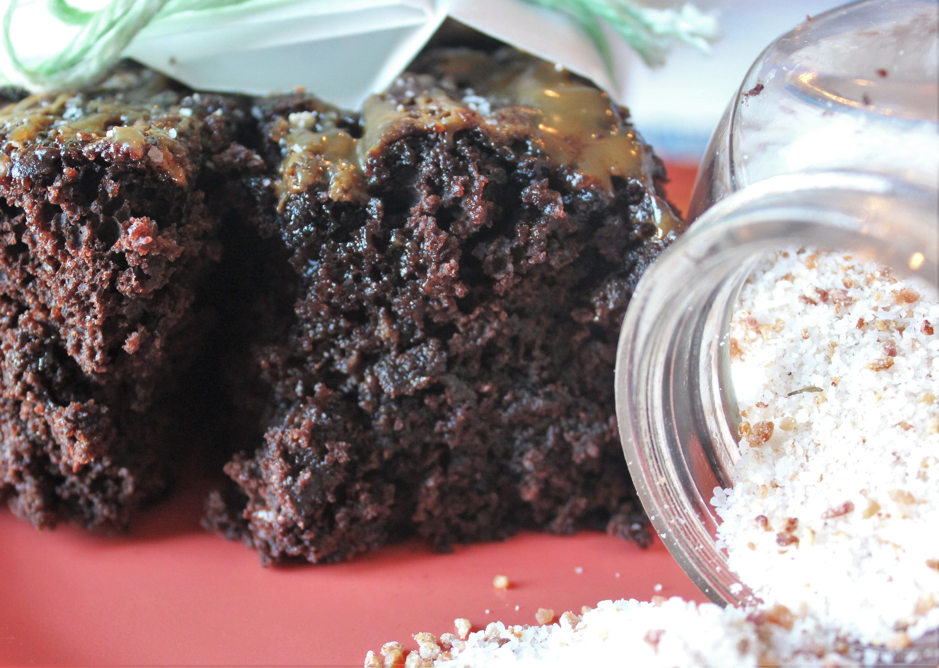 Dark Chocolate Brownies with a bottle of Bacon Salt tipped over and spilling out