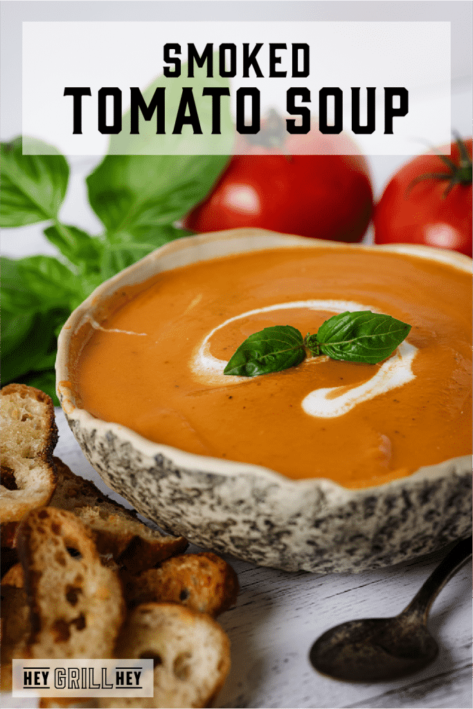 Bowl of smoked tomato soup with text overlay - Smoked Tomato Soup.
