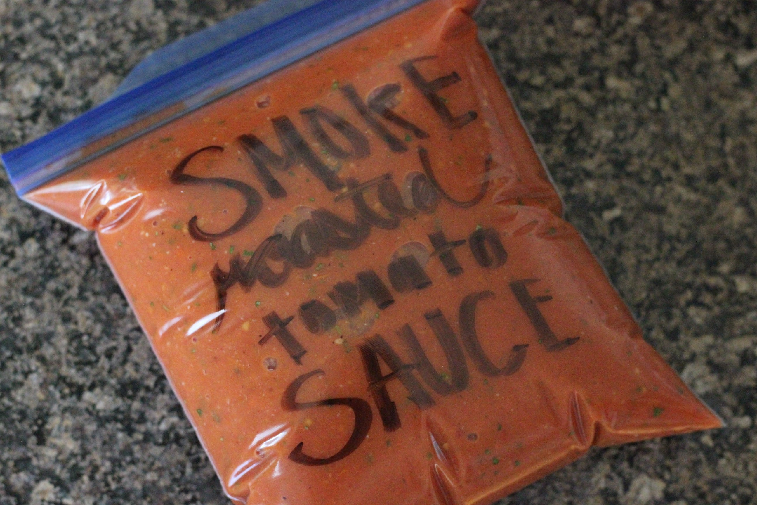 smoke roasted tomato sauce in a zip top bag.