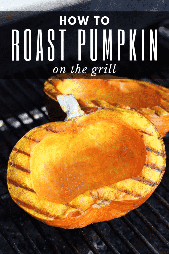 """Pumpkin sliced in half and cleaned out. Pumpkin is grilling on the grill grates inside the grill. Text overlay reads """"How to Roast Pumpkin on the Grill."""""""