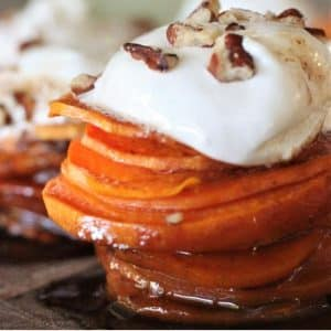 Candied sweet potato stack topped with marshmallow fluff and pecans.