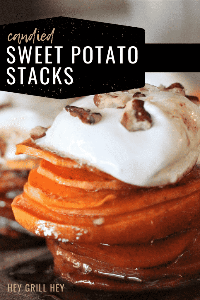 Candied sweet potato stack topped with marshmallow fluff and pecans. Text overlay reads: Candied Sweet Potato Stacks.