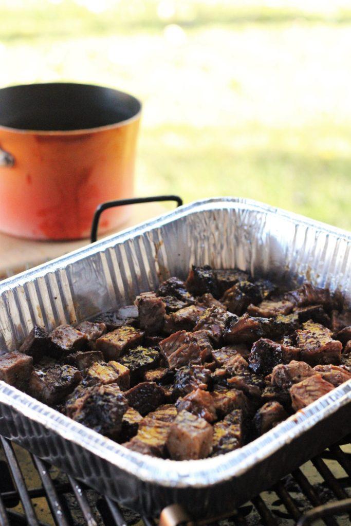 poor man's burnt ends in a foil baking pan.