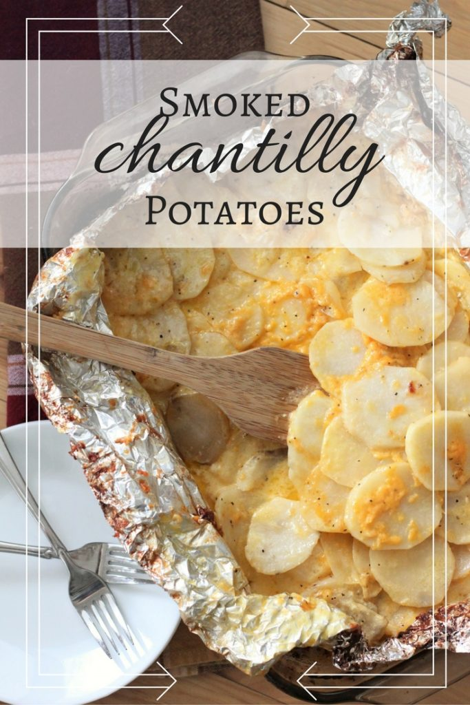 Smoked Chantilly Potatoes topped with cheese and served on a metal baking sheet.