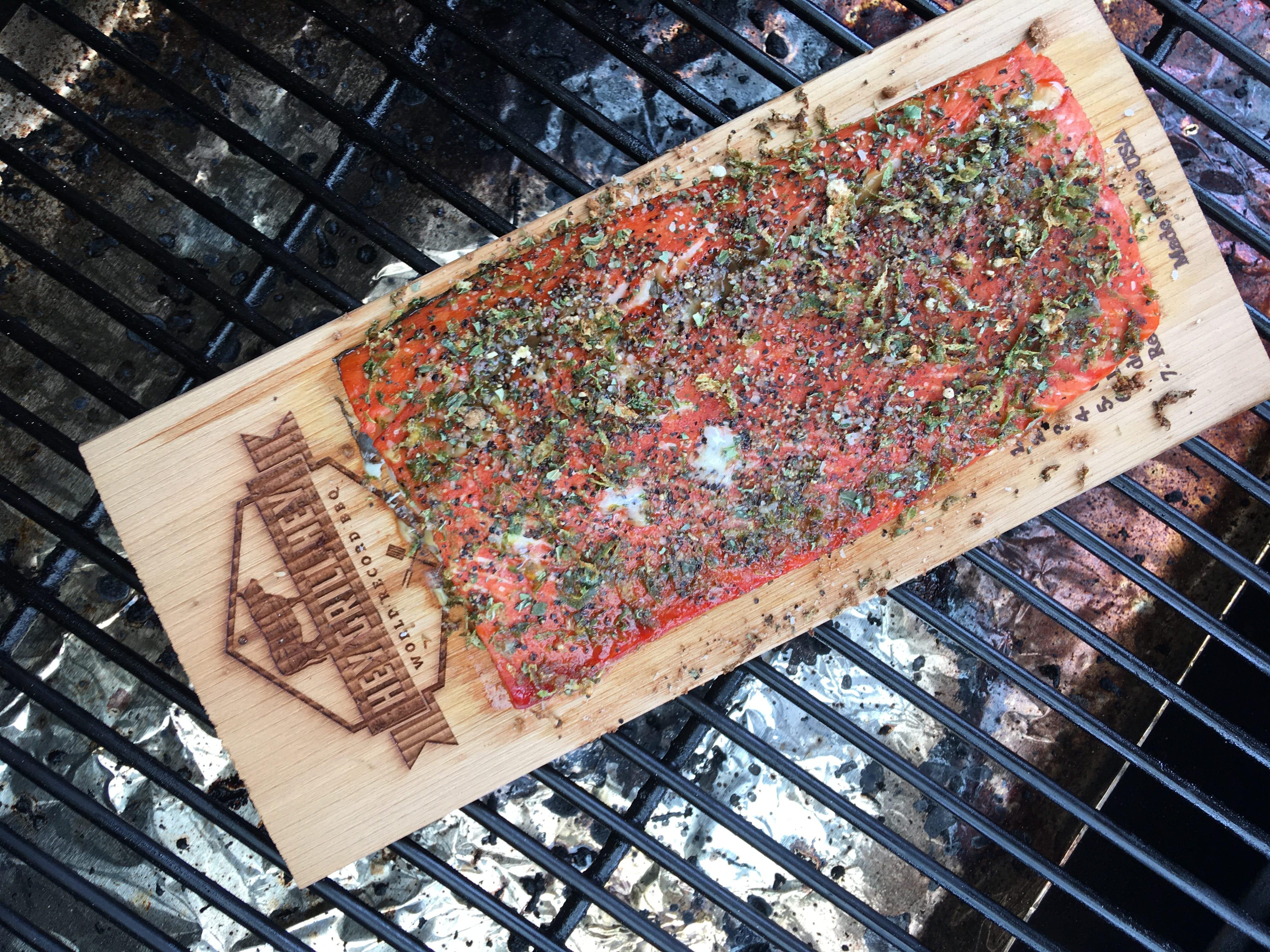 Cedar Plank Salmon on a cedar plank on the grill.