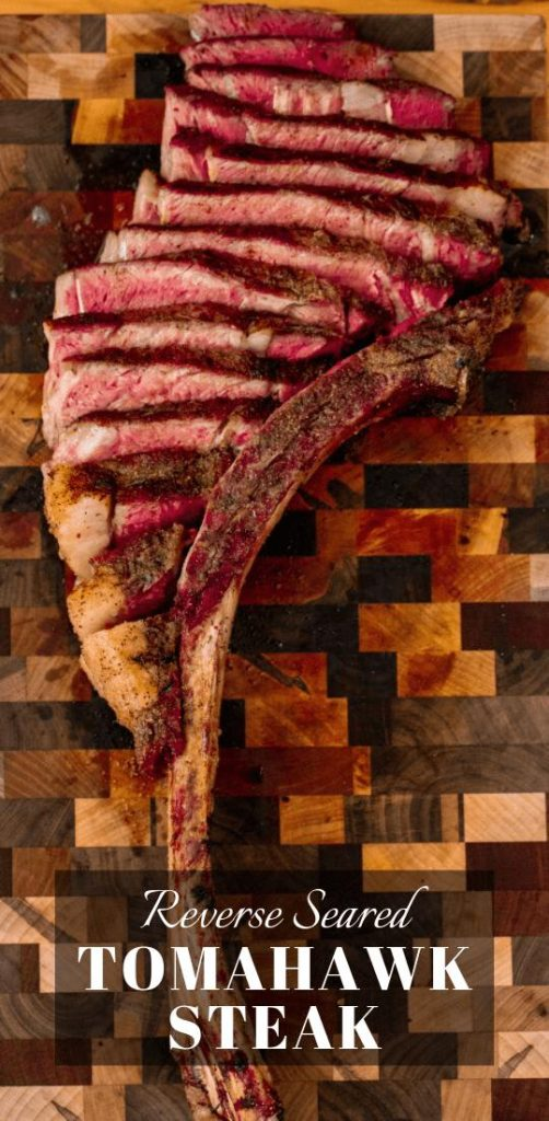 """Grilled Tomahawk steak sliced and served on a wooden cutting board. Text Overlay reads """"Reverse Seared Tomahawk Steak."""""""