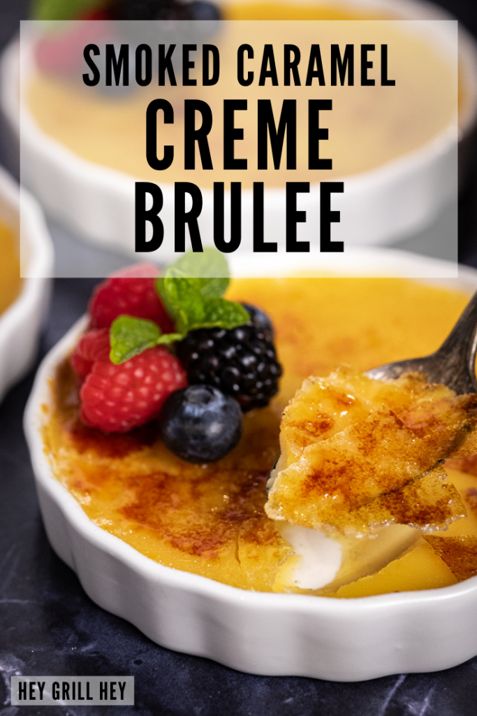 A spoon taking a scoop of caramel creme brulee out of a ramekin of creme brulee. Text overlay reads: smoked caramel creme brulee.