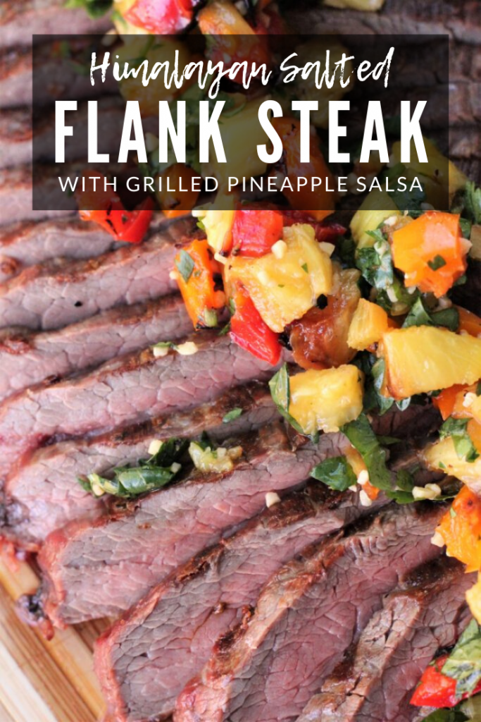 Himalayan salted flank steak sliced and topped with grilled pineapple salsa. Text overlay reads: Himalayan Salted Flank Steak with Grilled Pineapple Salsa.