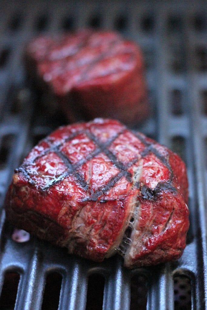 steaks on a grill.