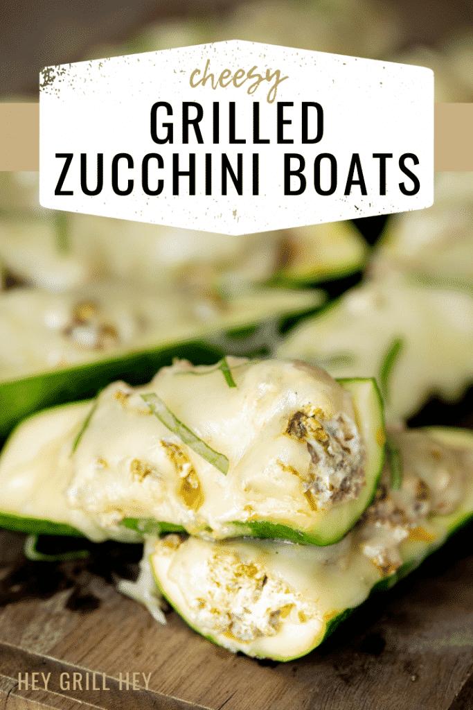zucchini boats on a wooden cutting board.