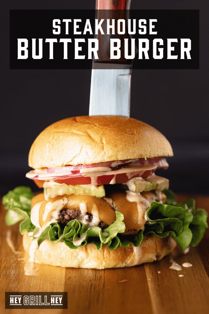 Chef's knife in a steakhouse butter burger with text overlay - steakhouse butter burger.