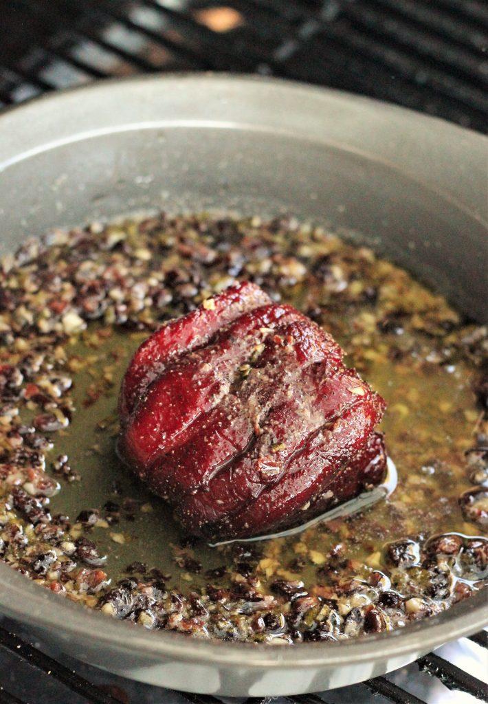 Venison Steak in a frying pan.