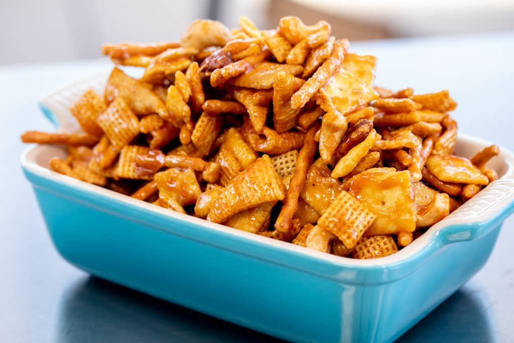 Smoked snack mix in a blue baking dish.