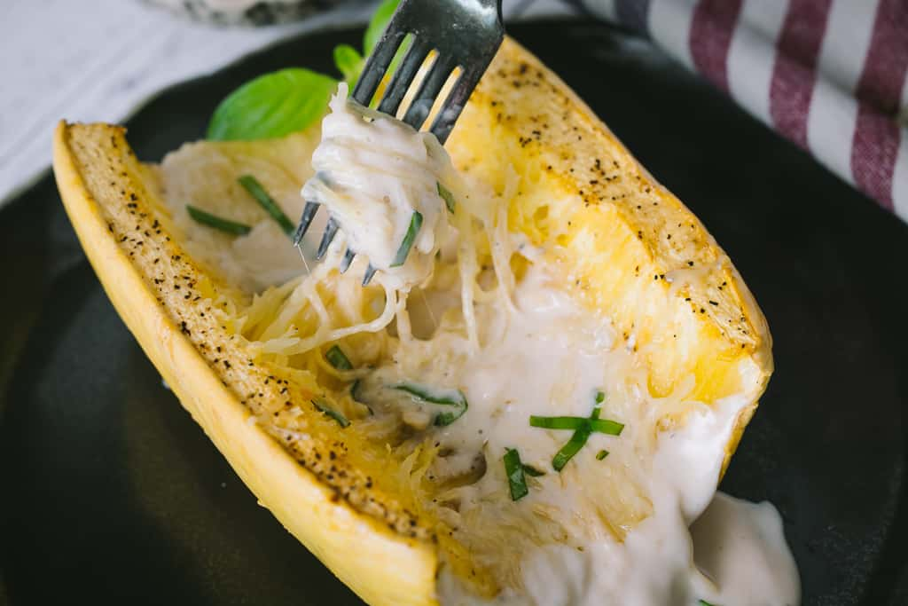 Grilled spaghetti squash topped with alfredo sauce.