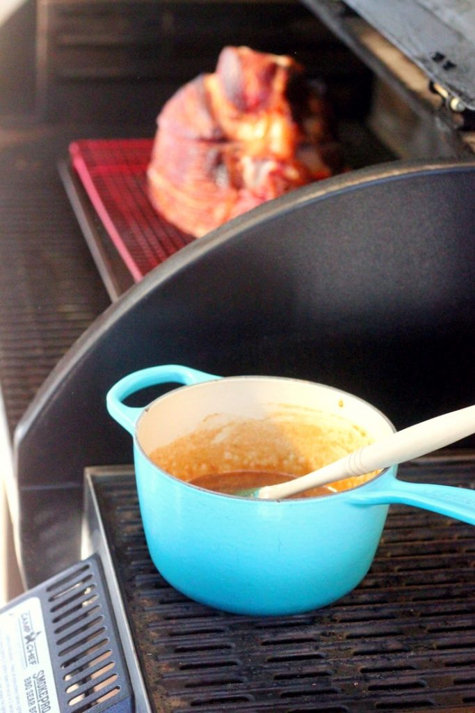peach glaze in a pan on the grill.
