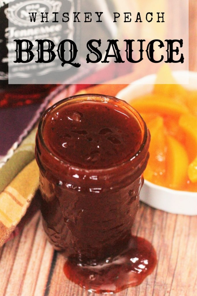 Whiskey Peach BBQ Sauce Recipe on a cutting board with peaches in the background.