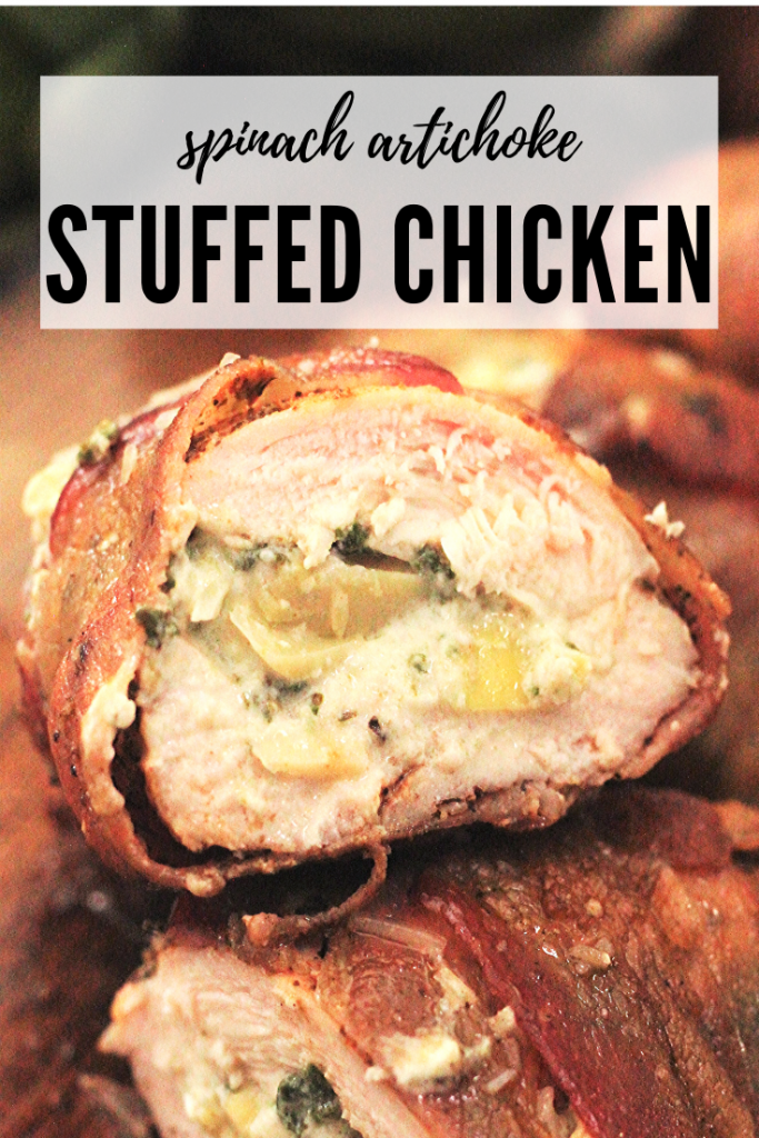 Cross section image of chicken breast stuffed with spinach artichoke filling wrapped in bacon.