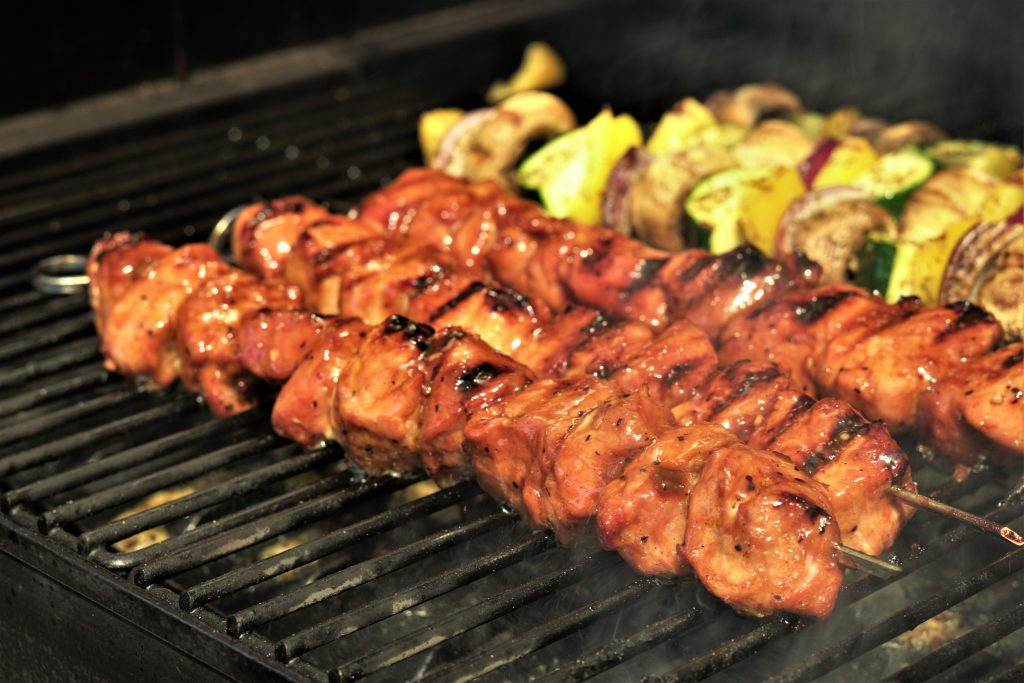grilled pork kabobs and vegetables kebabs on the grill grate.