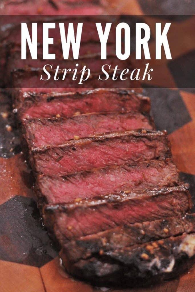 Sliced strip steak on a wood cutting board.