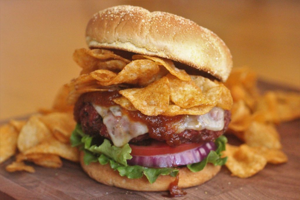 burger on a wooden table.