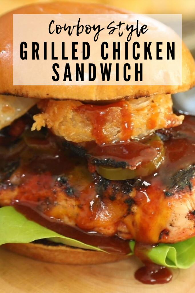 chicken sandwich on a wooden cutting board.