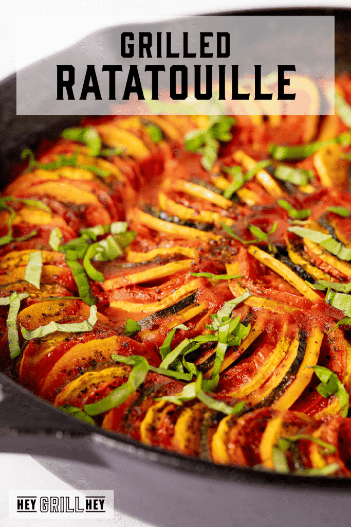 Grilled ratatouille in a cast iron skillet with text overlay - Grilled Ratatouille.