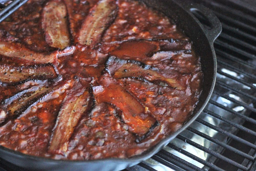 Smoked Baked Beans on the Grill in a cast iron skillet.