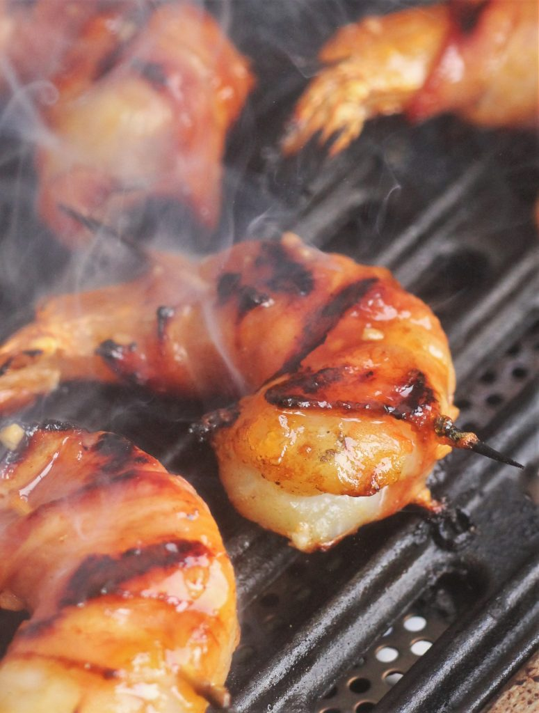 shrimp cooking on a grill