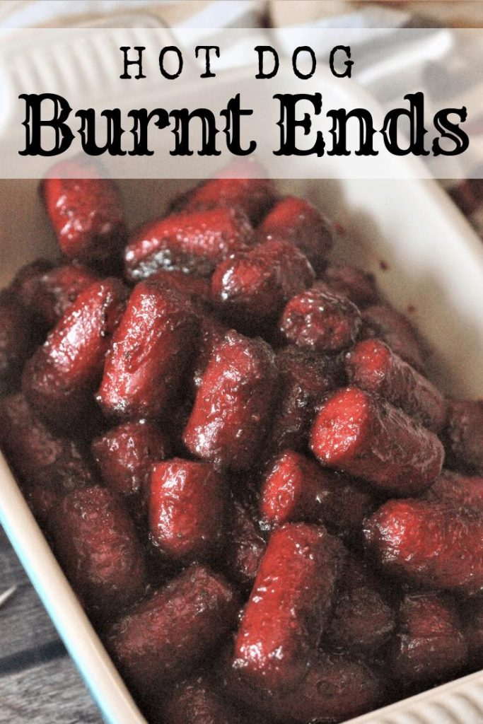 Cooked hot dog burnt ends piled in a white ceramic dish.