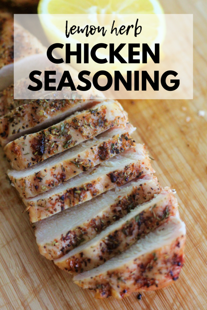 """Sliced and seasoned chicken breast on a wooden cutting board with half a lemon in the background. Text overlay: """"Lemon Herb Chicken Seasoning."""""""